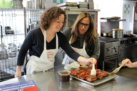 Candice and I basting the spareribs - and taking our job seriously